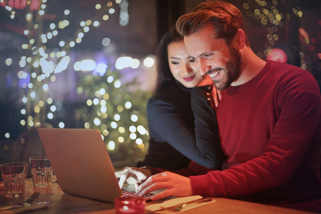 Couple buying things online on black friday cyber monday